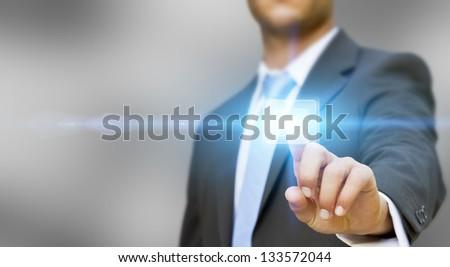 Businessman touching tactile interface - stock photo