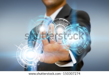Businessman touching tactile interface - stock photo