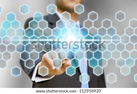 Businessman touching tactile screen