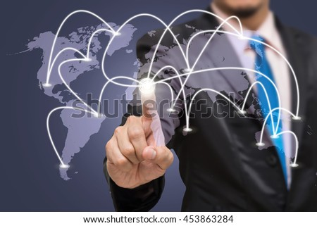 Businessman touching the center point of connection line of global network on world map with dark blue background, business connection concept