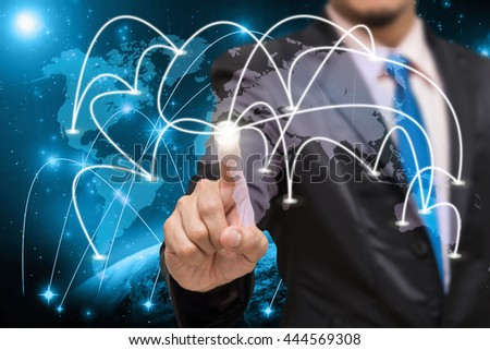 Businessman touching the center point of connection line of global network on world map with Part of earth network line background, business connection concept,Elements of this image furnished by NASA - stock photo