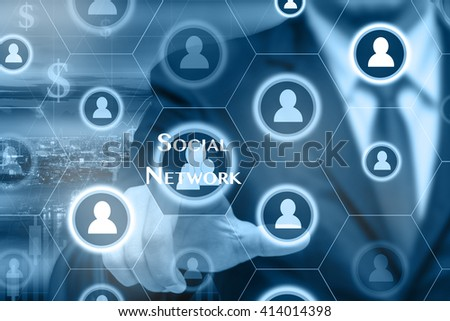 Businessman touching the Social network icon on Trading graph on the cityscape at night background, Business technology concept  - stock photo