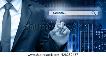 Businessman touching the virtual searching bar on the trading graph over the cityscape blurred background, Internet concept,Elements of this image furnished by NASA