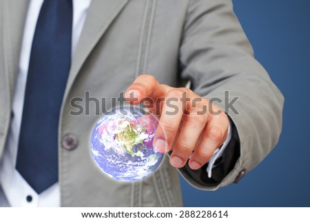 Businessman touching virtual globe.Elements of this image furnished by NASA. - stock photo