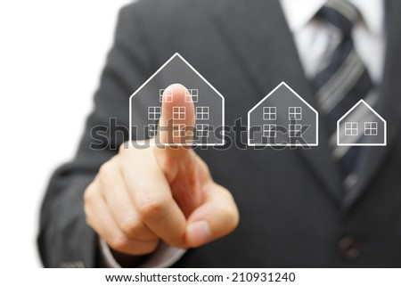 Businessman touching virtual house. Mortgage,house savings or real estate concept               - stock photo