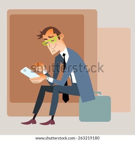 Businessman traveler in a suit sitting on the bag and reads smartphone
