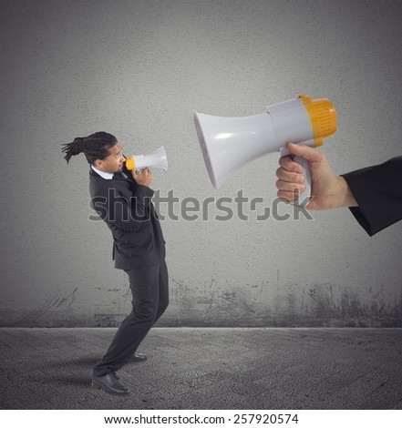 Businessman tries to counter the authoritarian boss - stock photo
