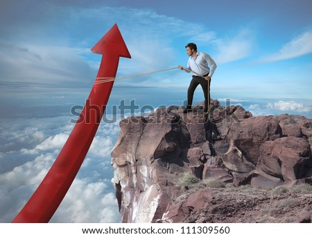 Businessman tries to raise the statistics over a mountain - stock photo