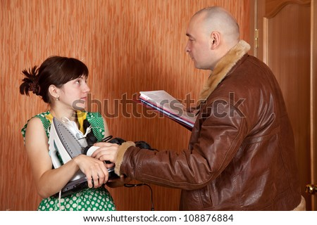 businessman trying to collect debt  from housewives - stock photo