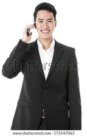 Businessman trying to listen to the speaker on the phone