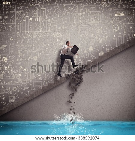 Businessman trying to overcome break step scale - stock photo