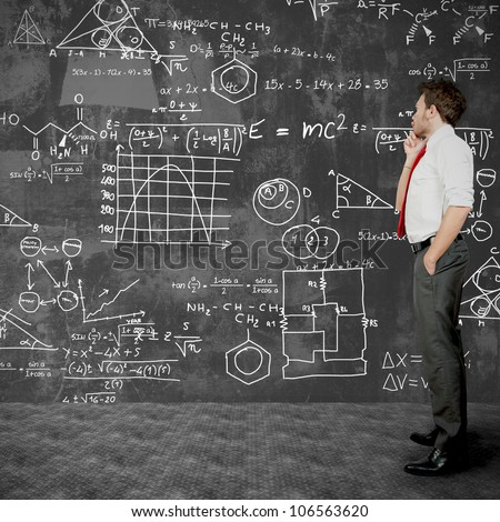 Businessman trying to solve problems - stock photo