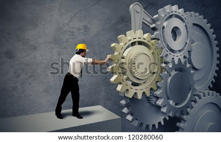 Businessman turning a gear business system - stock photo