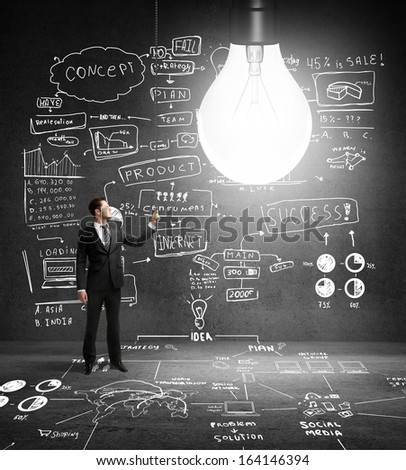 businessman turns on lamp and drawing business concept - stock photo