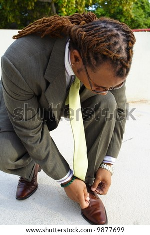 Businessman Tying His Shoe Lace