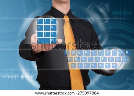 Businessman typing on a virtual keyboard - stock photo