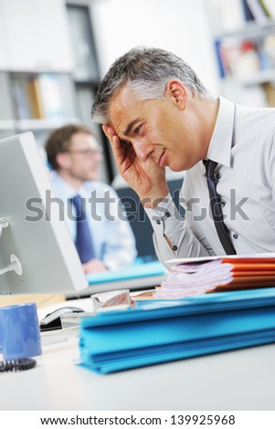 Businessman under stress, fatigue and headache - stock photo