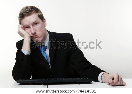 businessman unhappy at his desk thing are not going well today