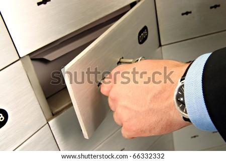 businessman unlocking safe - stock photo