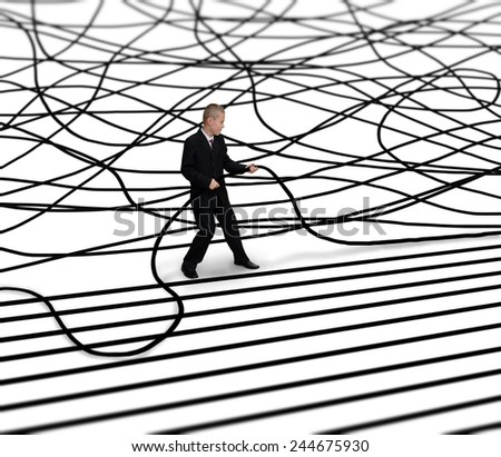 businessman unravels cable - stock photo