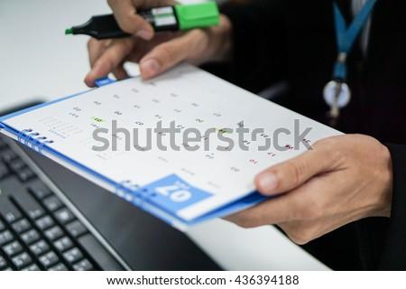 Businessman update the meeting calendar - stock photo