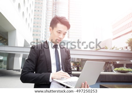 businessman use computer in honkong, asian