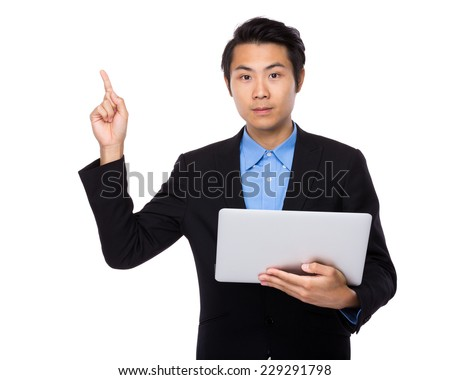 Businessman use laptop and finger point up - stock photo