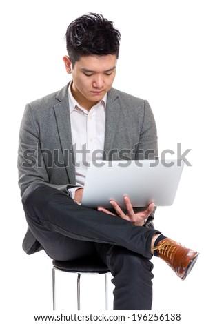 Businessman use laptop computer - stock photo