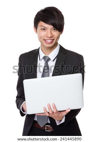 Businessman use of laptop - stock photo