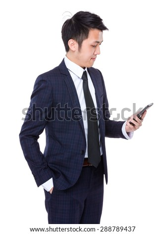 Businessman use of the digital tablet