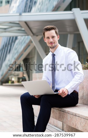 Businessman use of the laptop computer at outdoor