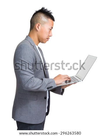 Businessman use of the notebook computer