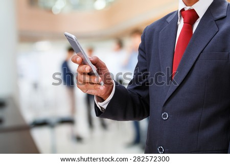 businessman use smartphone in office - stock photo