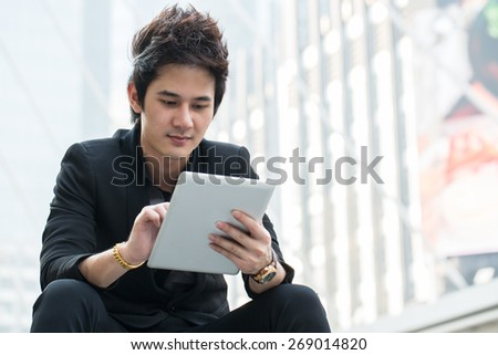 Businessman use tablet for search information and check report in the outside - stock photo
