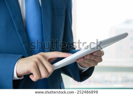 Businessman use the Tablet PC - stock photo