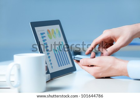 Businessman uses the new media technologies and devices to work successfully.