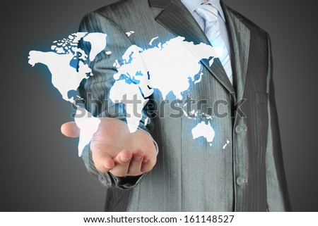 Businessman uses virtual map on dark background