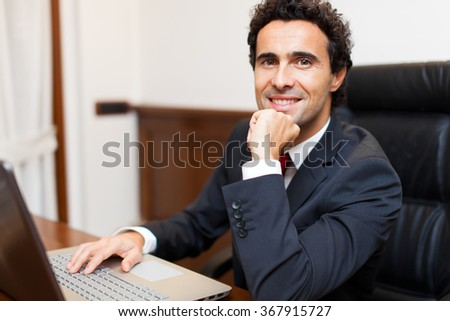 Businessman using a computer in his office