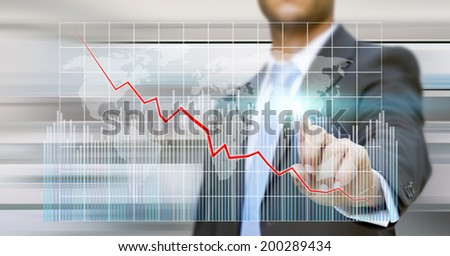Businessman using a digital chart during a meeting - stock photo