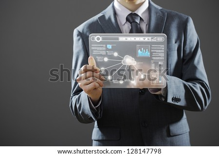 Businessman using a digital tablet - stock photo
