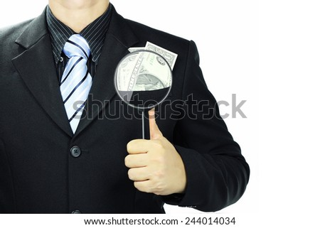 Businessman using a magnifying glass focus dollars in his pocket. Isolated on white background. Copy Space. - stock photo