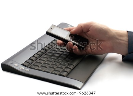 Businessman using a mobile phone and keyboard. Isolated on white background
