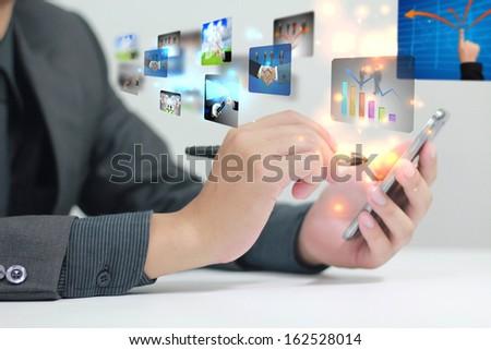 Businessman using a smart phone - stock photo