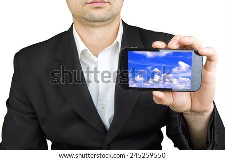 businessman using a smart phone with sky background - stock photo