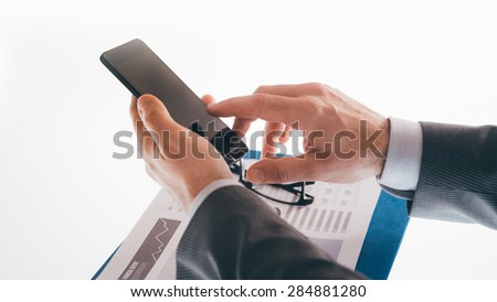 Businessman using a smartphone hands close up, unrecognizable person