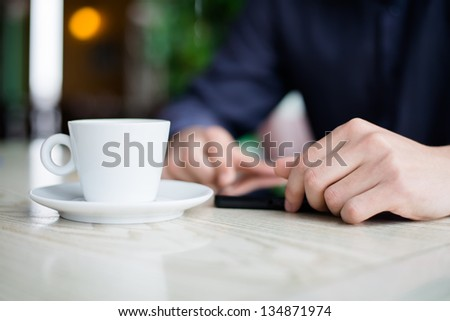businessman using a tablet and drinking coffee - stock photo
