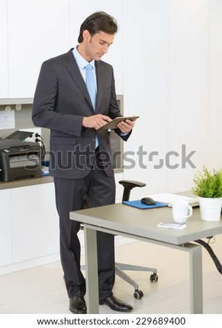 Businessman using a tablet in the office