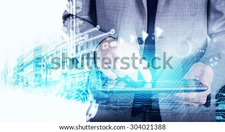 Businessman using a tablet with blueprint graphic - stock photo