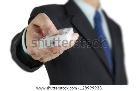 Businessman using air condition remote control, isolated background