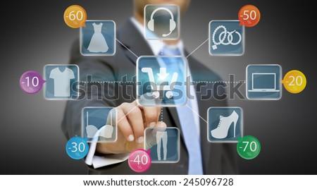 Businessman using digital interface to shop online - stock photo